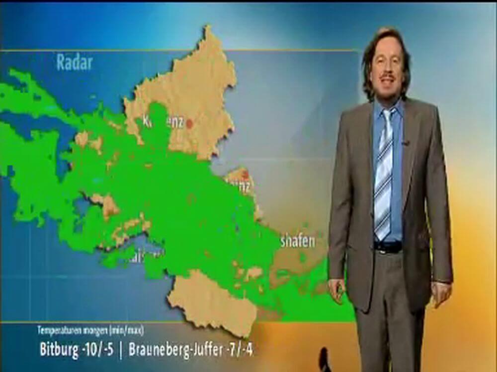 【猫の乱入】ドイツの天気予報に出現、気象予報士のおじさんに抱きかかえられる